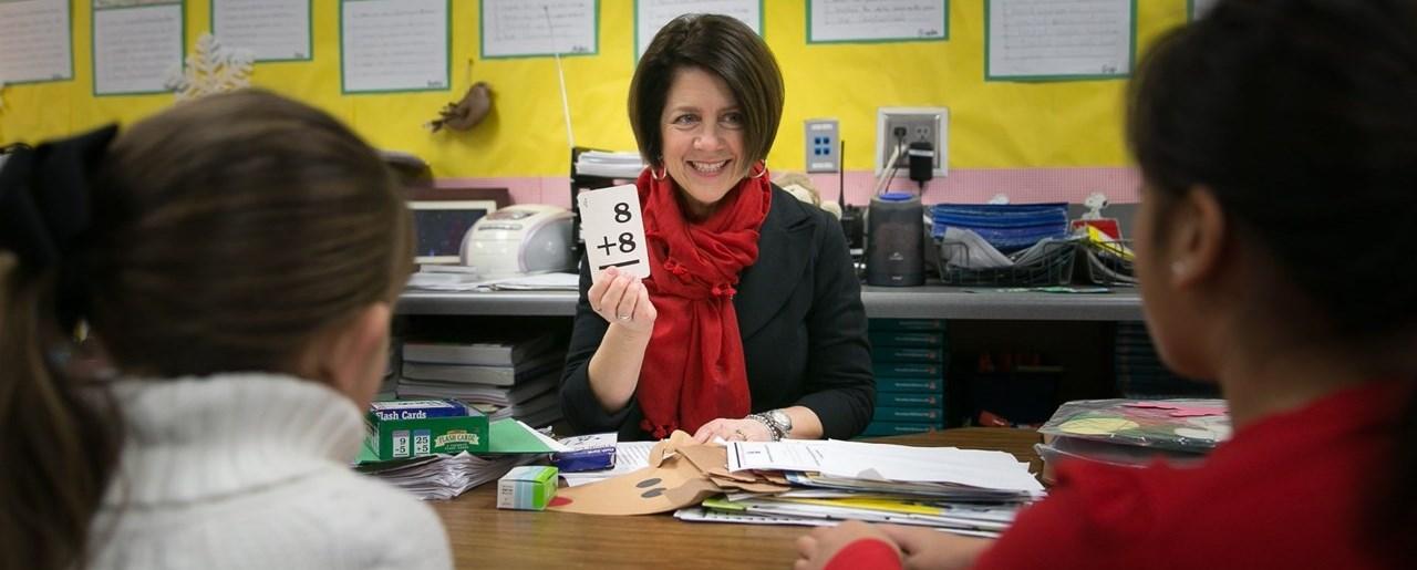 Fugman - teacher with flash cards